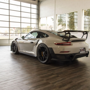Porsche GT2 RS on Smoked Oak flooring At Luxe Auto Spa