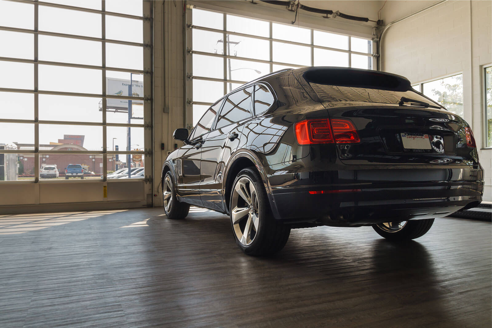 Bentley Bentayga at the Luxe Auto Spa, floored with Smoked Oak.