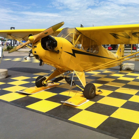 Black and yellow checkered airplane pad with edging.