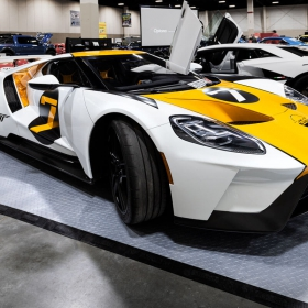 A Ford GT and a Lamborghini on display at the  Luxe Automotive booth with alloy diamond garage flooring.
