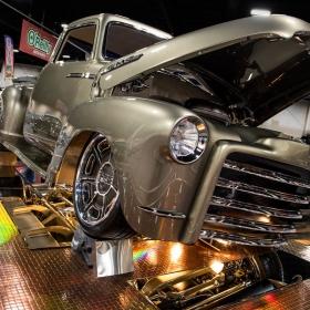 Kindig-It Design GMC truck on display on a prototype RaceDeck Diamond with metallic TuffShield.