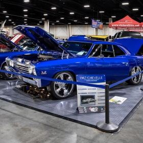 A 1967 Chevrolet Chevelle built buy Mile High Muscle in a car show booth with a RaceDeck Diamond floor.