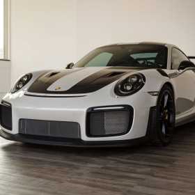 A Porsche GT2 RS on display at an auto detailer.