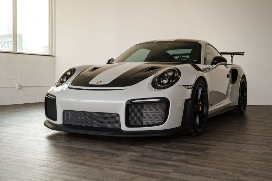 Porsche GT2 RS at a detailer parked on new Smoked Oak flooring.