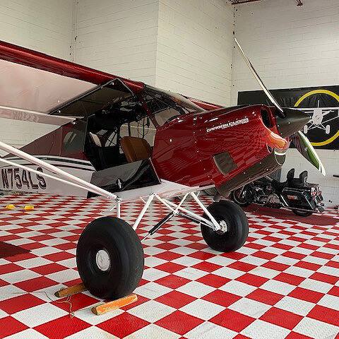 RaceDeck Diamond red and white in airplane hanger