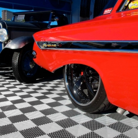 The Red Sled '61 Impala displayed on Free-Flow