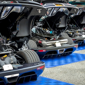 Supercars on display on Free-Flow parking pads