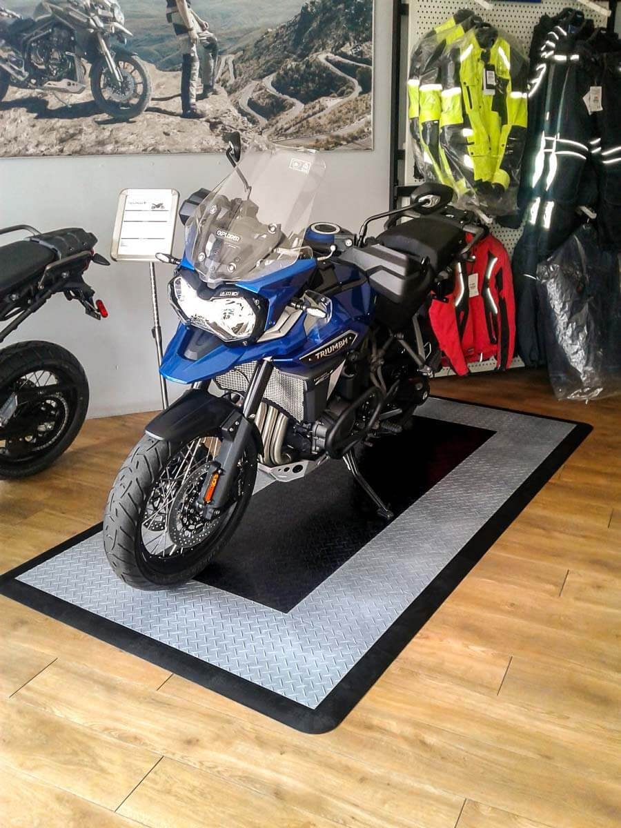 A Triumph Tiger Explorer parked on one of our RaceDeck Diamond™ bike pads