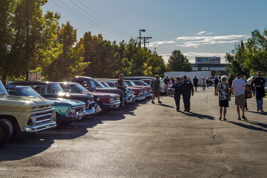 Members of the Hall of Fame Road Tour and RaceDeck crew discuss the cars and enjoy the event.