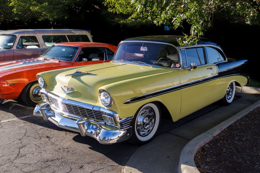Yellow and black classic Cadillac.