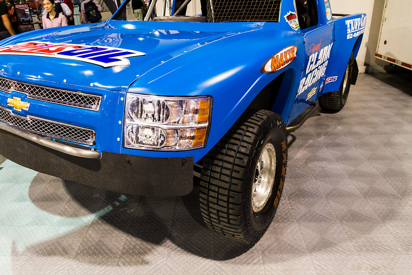 Off-road racing truck parked on RaceDeck Diamond