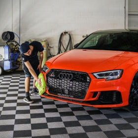 Audi RS3 in the wash bay on snap lock flooring