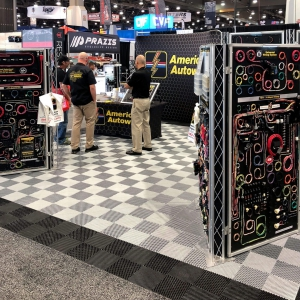 American Autowire booth with black and alloy Free-Flow flooring