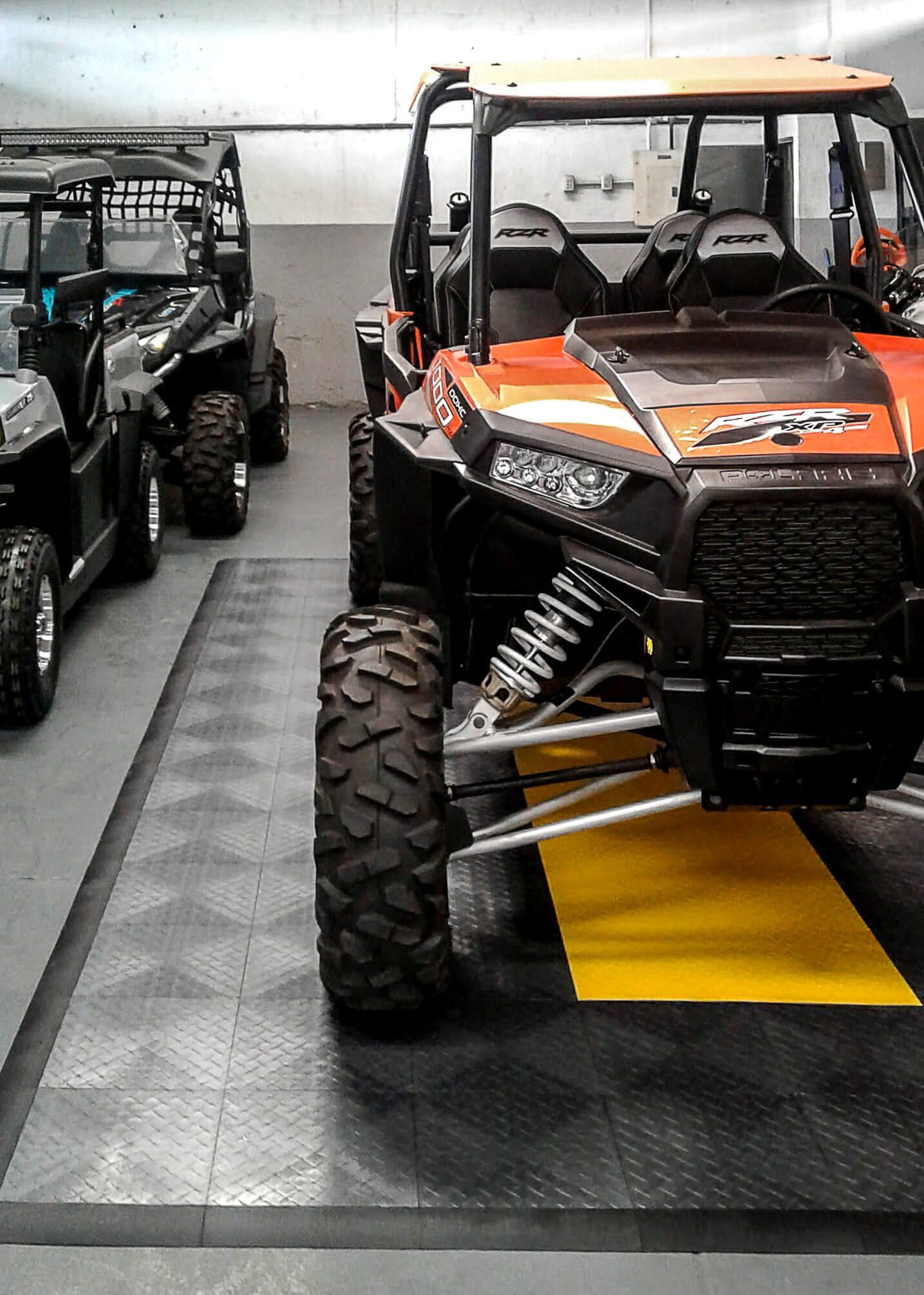 4 Wheelers in a garage with RaceDeck Diamond parking pad