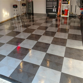 Glossy RaceDeck Diamond with Tuffshield sets the stage for this clean home garage.