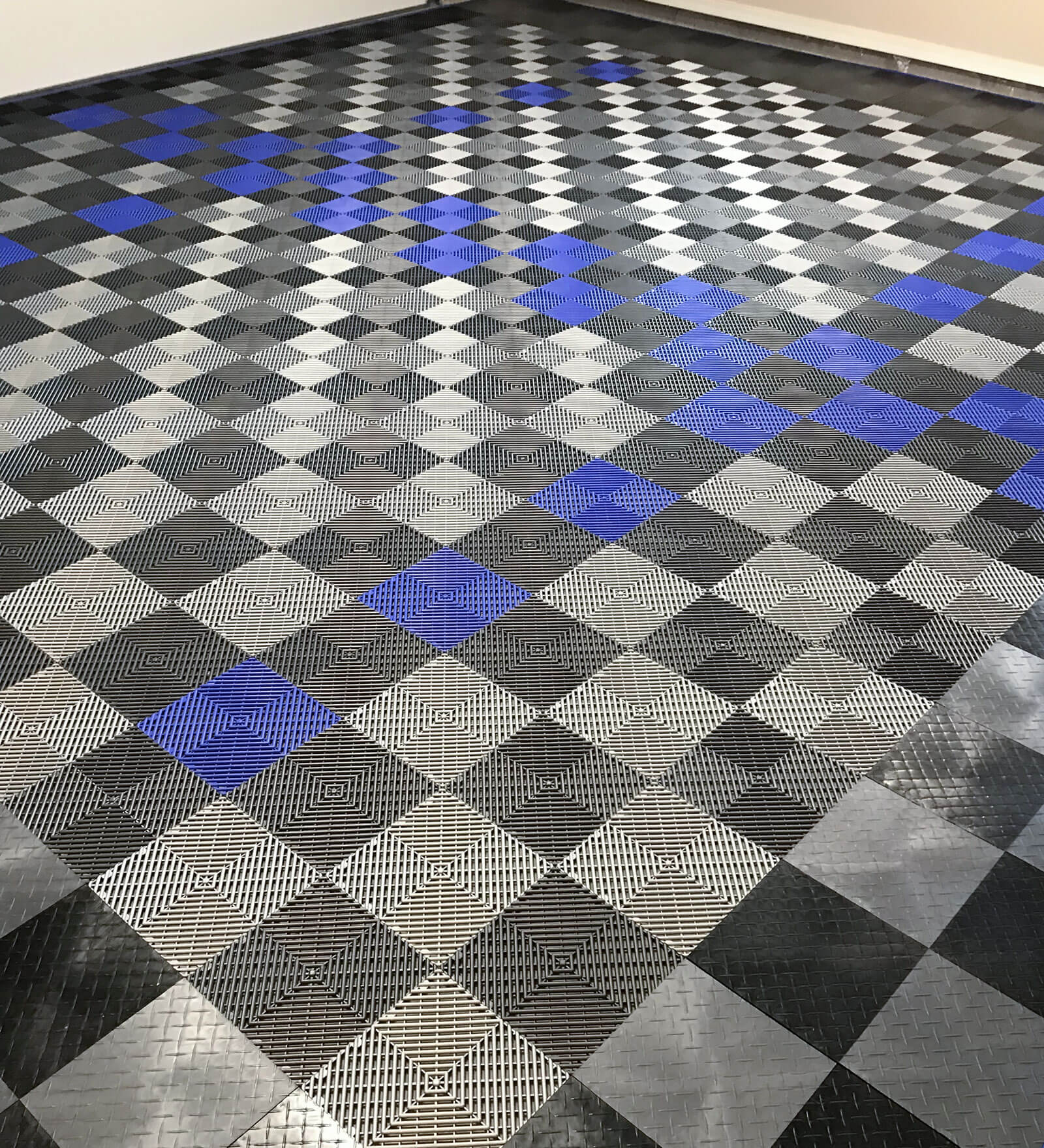 RaceDeck Diamond and Free-Flow in a custom pattern for this home garage.