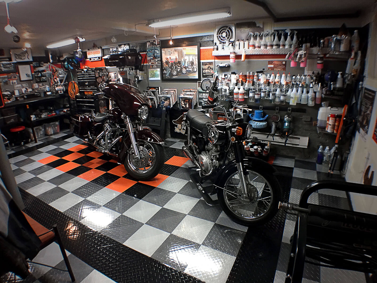 Harley garage in Quebec with high-gloss Diamond TuffShield flooring to match.