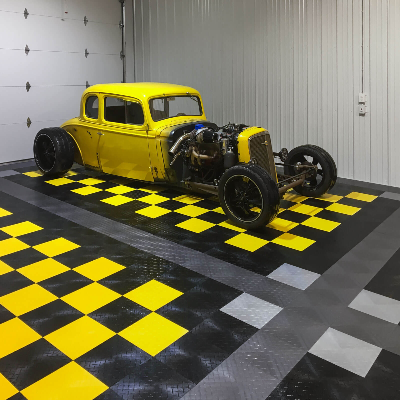 Yellow Rat Rod in matching yellow, black, graphite and alloy RaceDeck Diamond garage