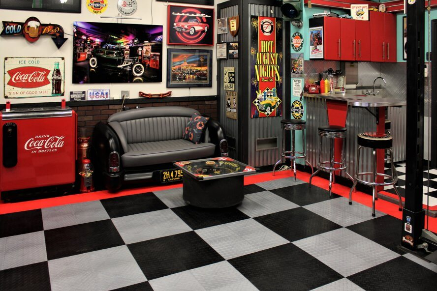 Tony Dekellis - Seating area with 51 Mercury couch and NASCAR tire table