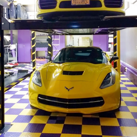 Yellow-purple themed garage with Corvettes