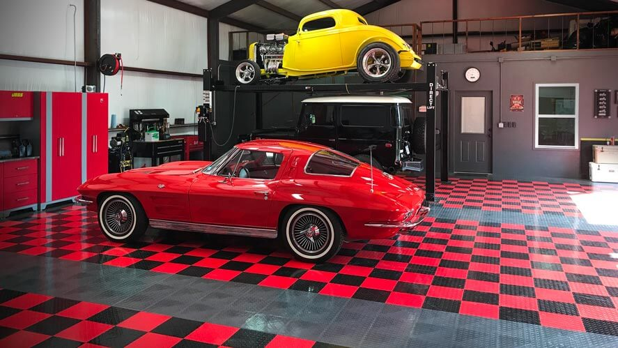 car guy garage with a '63 sting ray, hot rod, and Land Cruiser