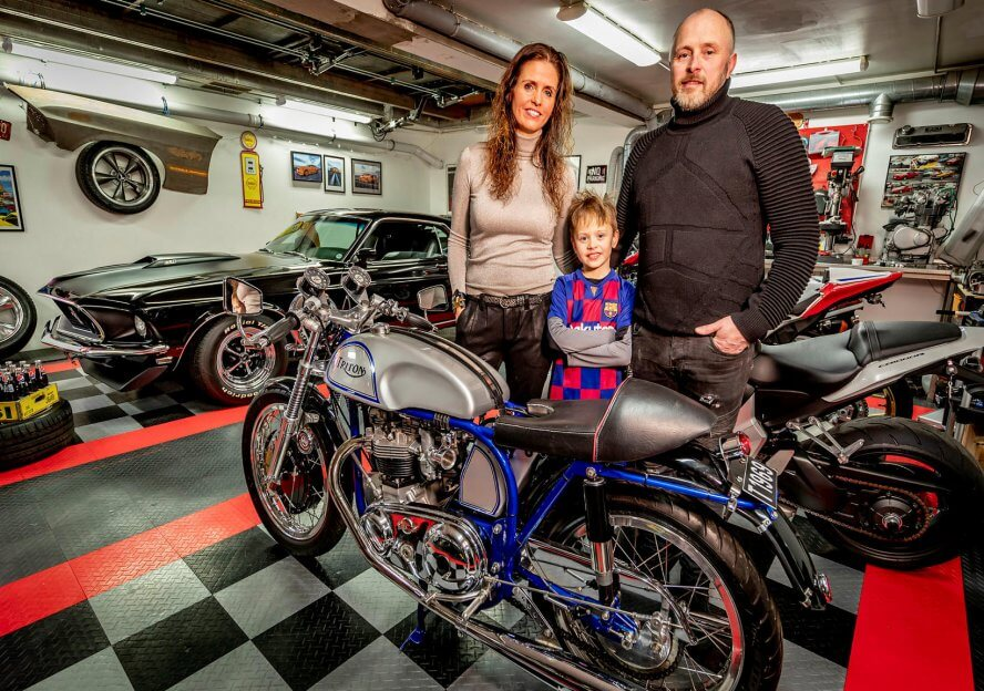 Guðmundur and Maríu with their son in their garage