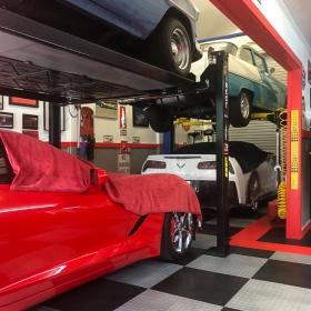 Multi-car garage with lifts on RaceDeck XL flooring