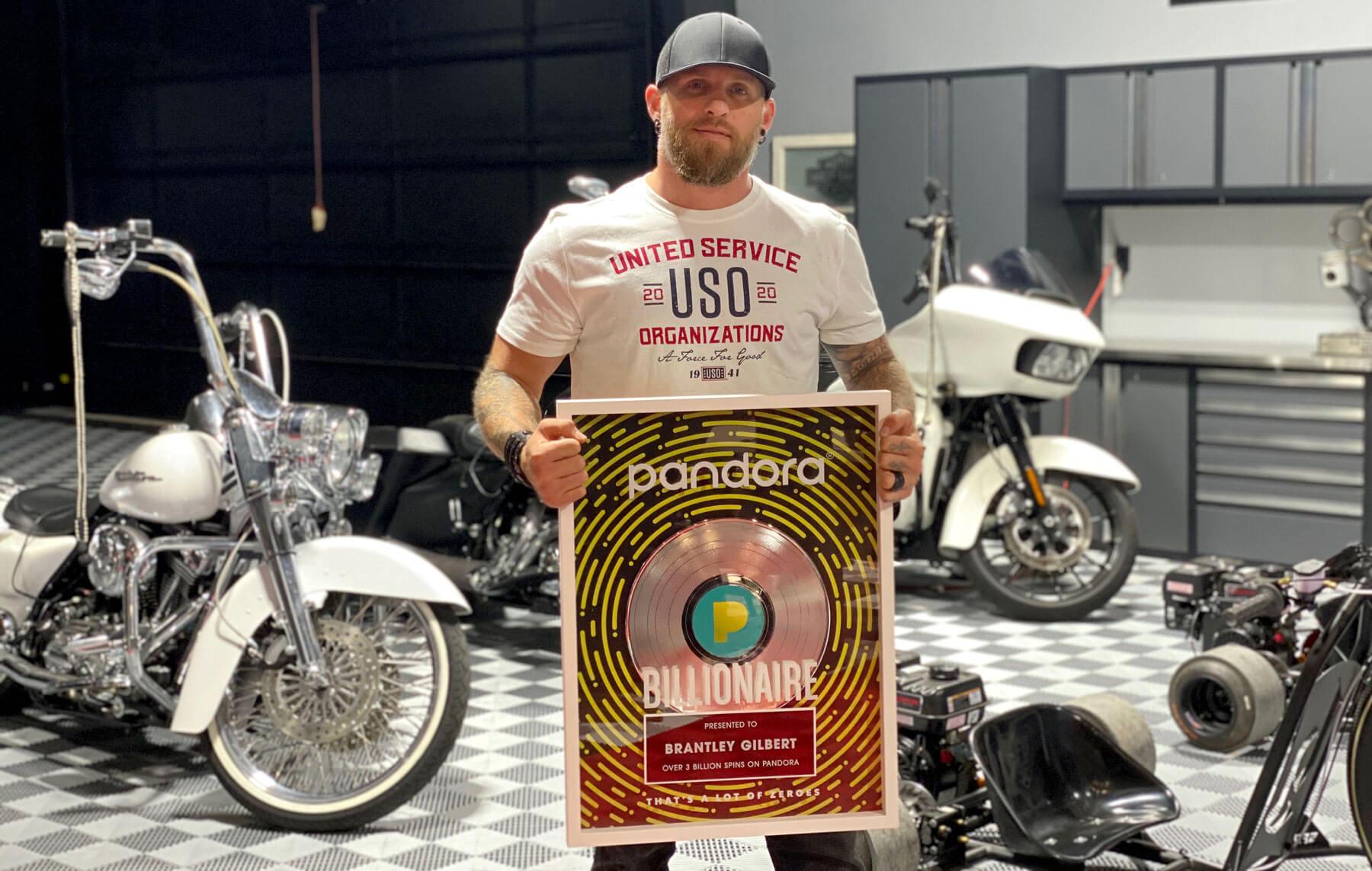 Brantley Gilbert shows his Pandora Billionaire award in his RaceDeck Free-Flow garage