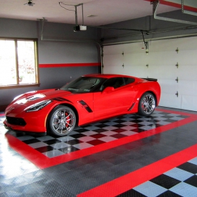 Tuffshield flooring in graphite, red, black and alloy to match this Corvette garage
